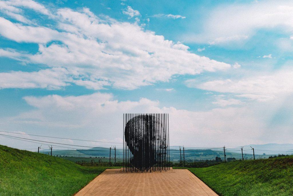 Sculpture of Mandela transparency & nature